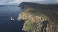 Flying towards and over rugged cliffs of Cape Hauy in Tasman National Park Stock Footage