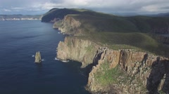 Flying away from rugged cliffs of Cape Hauy at Tasman National Park, Tasmania Stock Footage