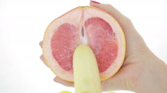 Concept of sex. grapefruit and banana. close-up Stock Footage