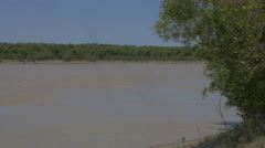 Muddy East Alligator River flows through Kakadu, Australia Stock Footage