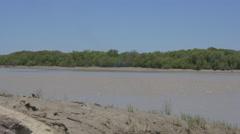 Muddy East Alligator River flows on through Kakadu, Australia Stock Footage