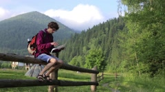 Man tourist in mountain read the map. Man on top of mountain. Tourism concept Stock Footage