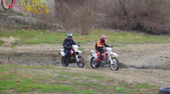 Pair of motorcyclists take the start Stock Footage