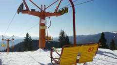 Chair lift transportation system, skiers transport while suspended off ground Stock Footage
