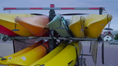 Colorful kayaks on transport in Ireland Stock Footage