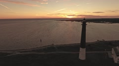 Aerial view of Sorve Lighthouse with sunset on background. Saaremaa, Estonia Stock Footage