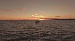 Low flying over fishing boat with sunset view. Saaremaa, Estonia Stock Footage