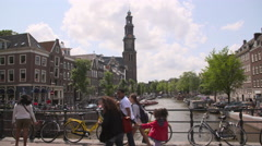 View of the Munttoren's clockwork and carillon from a bridge Stock Footage