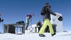 Group of tourists passing in front of a lookout point on a mountain peak, whe Stock Footage