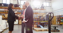 4K Businesswoman meeting with business associates in factory warehouse Stock Footage