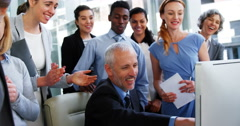 Group of Business people appreciating their colleagues works Stock Footage