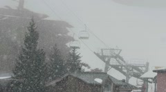 Heavy snow over some installations chairlift that climbs the steep and covere Stock Footage