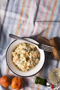 Traditional russian salad olivie prepared with mayonnaise and boiled vegetables Stock Photos