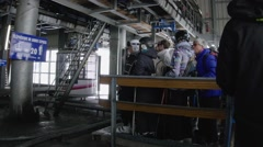 Group of skiers waiting to enter the cable car and when it all comes inside h Stock Footage