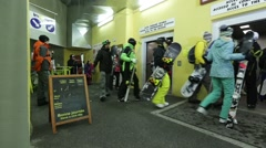 Group of skiers waiting for the elevator to go up to the ski slopes superior Stock Footage