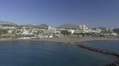 Aerial view of Playa de las Americas in Tenerife, Canary Islands Stock Footage