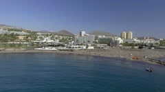 TENERIFE, SPAIN: Aerial view of Playa de Las Americas. The beach is the most Stock Footage