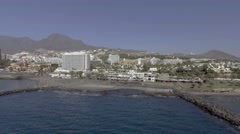 TENERIFE, SPAIN: Aerial view of Playa de Las Americas buildings. The beach is Stock Footage