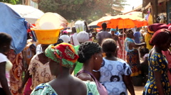 People buying and selling in city market - Guinea Africa Stock Footage
