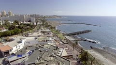 TENERIFE, SPAIN: Flying over Playa de Las Americas. The beach is the most famous Stock Footage
