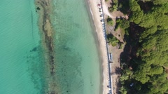 Overhead view of Torre Mozza Beach and Tower, going down Stock Footage