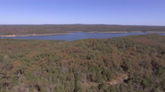 Large lake  in the background of forested area during autumn Stock Footage