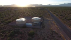 Aerial pullback of water tanks Stock Footage