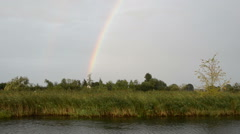 Havel river landscape (Brandenburg, Germany) with willow tree. rainbow Stock Footage
