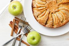 Homemade apple pie on white table Stock Photos