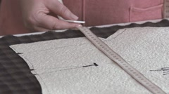 Slowmotion. Cutting fabrics. The material in the cell. Cotton fabric Stock Footage