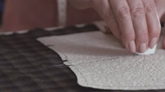 Close-up of the hands of a seamstress. White chalk fabric Stock Footage