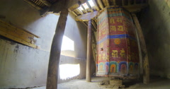 Ancient prayer wheel in a lamasery (gompa) of Ladakh Tiksi Stock Footage