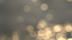 Abstract Background Bokeh Golden Glare on Water Stock Footage