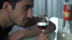 Profile of drunk man while drinking nervously  a glass of liquor Stock Footage