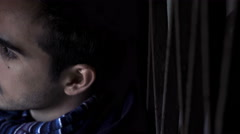 Serious creepy young man in twilight looks at the camera Stock Footage