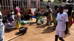 Women in city market shoping goods - Guinea Africa Stock Footage