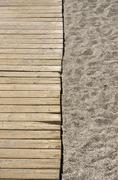 Half walkway Half sand Stock Photos