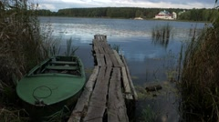 Pier and Boat on a Reed Shore of the Lake  Stock Footage