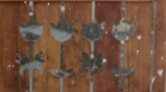 Heavy snow falling in front of a wooden fence painted in brown Stock Footage