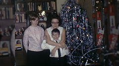 Happy Family Hug Kiss Together by Christmas Tree Vintage Film Home Movie 10277 Stock Footage