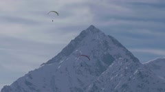 Paragliders flying over some snowy peaks at high altitude Stock Footage