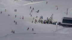 Skiers standing in line at the chairlift seen on steamed window of the cable Stock Footage