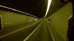 Time lapse driving along the orange tunnel at night  Stock Footage