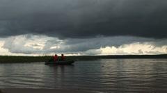 River, rowing boat, dark grey sky Stock Footage