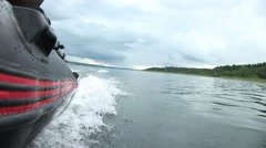 Inflatable boat. View from the side of a moving inflatable boat in cloudy wea Stock Footage