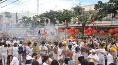 Firecrackers explode over devotees of Chinese shrine Stock Footage