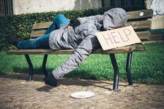 A homeless begging money because poor Stock Photos