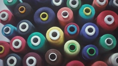 Sewing Threads On Spool. Closeup. Colorful spools of thread Stock Footage