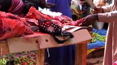 Man butcher street seller city market Bandim - Guinea Africa Stock Footage