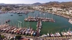 Marina aerial yacht business boat harbor luxury tourism coastline travel drone Stock Footage